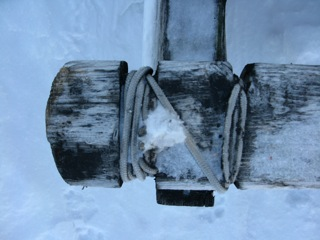 Plank sled (komatiks cross pieces) are attached by using rope lashing - to give the sled flex over the rough drifted snow and sea ice.