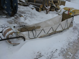 In areas of deep soft snow, toboggans are often used instead of the traditional basket dog sleds.