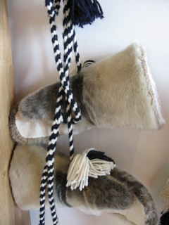 Mittens are an important clothing item in the cold and windy High Arctic.  Braided yarn neck ropes keep the mittens from blowing away in the wind.