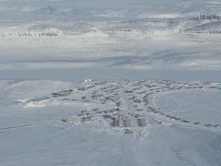 Flying the Polar Pumpkin over the village of Ulukhaktok on the way to the North Pole