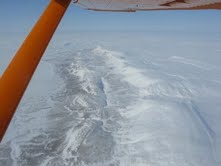 The vast expanse of the Canadian High Arctic, framed by the wing of the Polar Pumpkin.